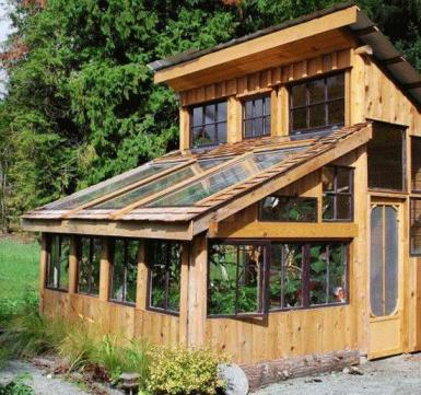 One ideas is to build the greenhouse using wooden structures and second hand windows.